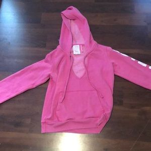 a pink v- cut hoodie